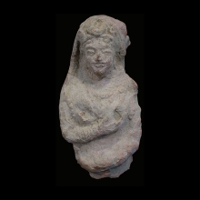 An Indus Valley clay bust of a woman, Kushan Period