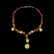 An Indus Valley necklace comprising ancient carnelian and gold