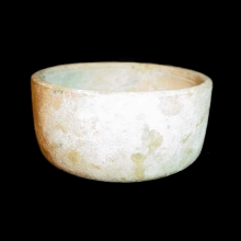 An Islamic pale green glass bowl.