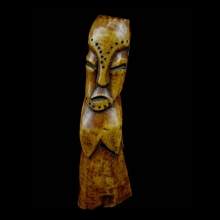 An old Lega hollow standing bone female ancestor figure