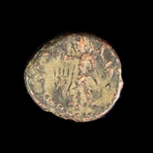Ancient Indian bronze coin, Kushan period