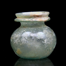 A Roman pale green glass vessel