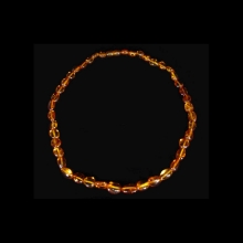 Baltic region amber bead necklace; some beads with microscopic inclusions.