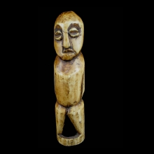 A very old Lega hollow standing figure carved from hippopotamus ivory; beautiful honey patina