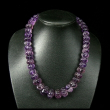 A strand of amethyst melon shaped beads.