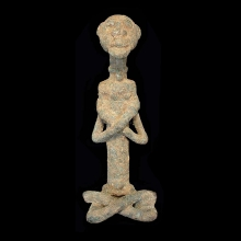Dogon bronze figure of a seated male