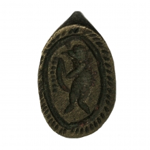 Persian bronze ring the bezel engraved with a depiction of a stylised figure