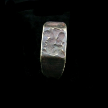 Neo-Assyrian bronze ring, the bezel engraved with a depiction of a fish god.