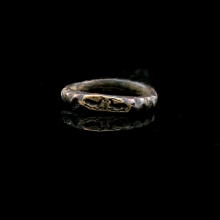 Hellenistic bronze ring the bezel engraved with a pair of crouching antelope
