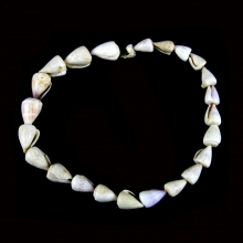 A small strand of ancient Badarian shell beads, Egypt