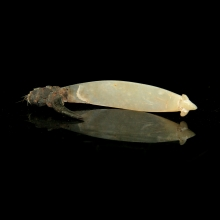 fish hook shell, turtle shell, glass (beads), fibre, Solomon Island.
