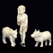A Chinese ivory carved group of a farmer and his cattle