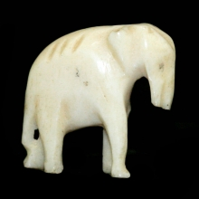 A miniature ivory carving of an elephant