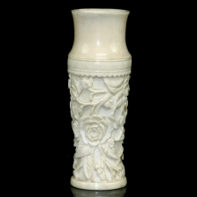 A Qing to Republic carved ivory vase with foliate motif in relief