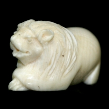 An ivory carving of a recumbent lion