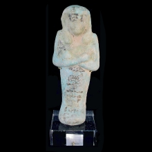 Egyptian faience Ushabti with details and hieroglyphs in a black glaze.