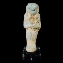 Egyptian faïence Ushabti with traces of black glaze decoration.