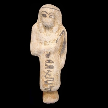 Egyptian gesso ushabti with details and hieroglyphs in a black glaze.
