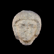 Egyptian limestone head of a male; wears short wig. Old kingdom