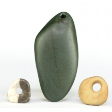 A group of three Egyptian Predynastic stone beads of various forms.
