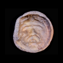 Gandharan clay mold of a bearded deity