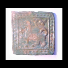 Ghaznavid green-glazed pottery tile decorated with mythological creature and dot motif.