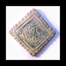 Ghaznavid green-glazed pottery tile decorated with partridge and fleur-de-lys motif.