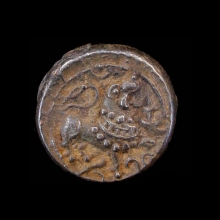 Indian silver coin with Shiva trident on one side and Nandi bull on reverse