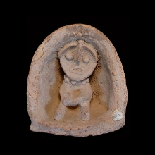 Indus valley terracotta shrine with figure, possibly a deity