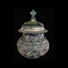 Kashmiri Buddhist copper lidded vessel with repousse floral decoration