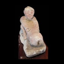 Limestone ithyphallic figure with remnant pigments.