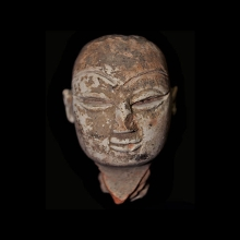 Mehrgarh clay head of a god