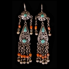 Pair of Pashtun silver tribal earrings with turquoise and coral beads