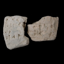 Pair of Sumerian clay tablet fragments, with cuneiform inscription