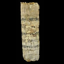 palm-leaf-scroll-with-proto-arabic-writing-in-black-pigmeent_x9164b