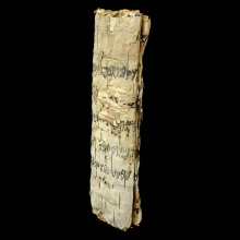 palm-leaf-scroll-with-proto-arabic-writing-in-black-pigmeent_x9164c
