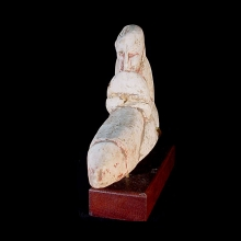 Roman Egyptian carved limestone ithy-phallic figure with remnant ochre pigment.