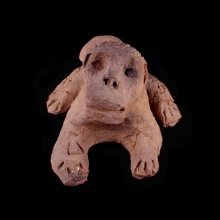 An ancient Sub-Saharan terracotta zoomorphic figure with simian features