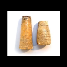 Two early Islamic ivory game pieces.
