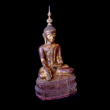 Burmese lacquered and gilded wood and papier mache seated Buddha