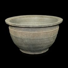 Han dynasty grey-ware pottery steamer in three sections.