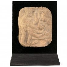 An ancient Indian clay plaque showing an erotic scene with male and female figures