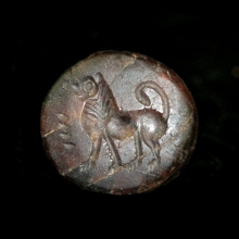 A Bactrian black stone stamp seal engraved with a mythical beast.