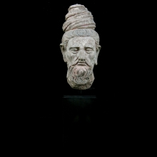 A very fine Gandharan stucco head of a Sage