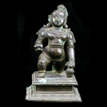 A finely cast bronze baby Krishna holding butter ball