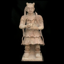 A Chinese sandstone guardian figure, Ming Dynasty.