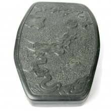 A late Qing to Republic carved black stone lidded ink grinding stone