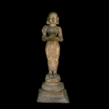An Indian solid bronze cast oil lamp in the form of the goddess Lakshmi.