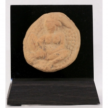 A Chandraketugarh clay plaque depicting a naked lady in erotic pose.
