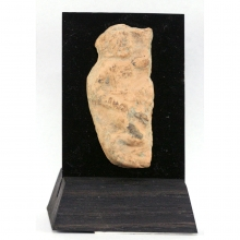 A Chandraketugarh clay fragment depicting a naked man in erotic pose.